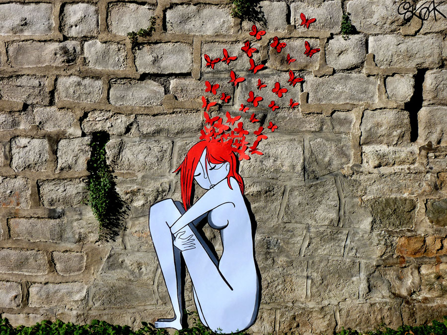 The girl with the red hair and the butterflies by Oakoak